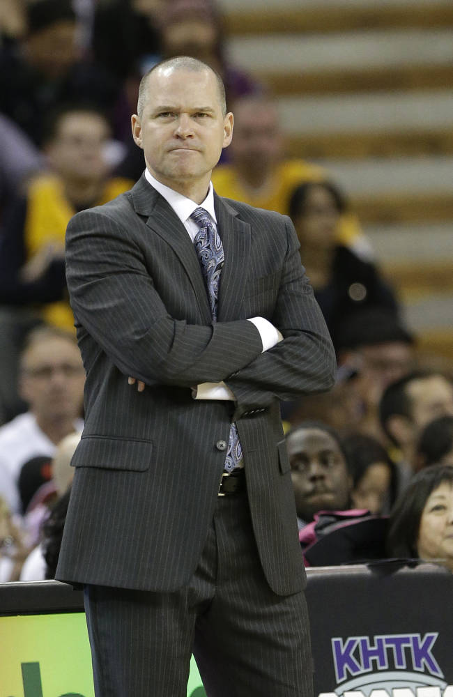 Sacramento Kings head coach Michael Malone grimaces as he watches the action during the fourth quarter of the Kings 106-100 loss to the Los Angeles Lakers in a NBA basketball game in Sacramento, Calif., Friday, Dec. 6, 2013