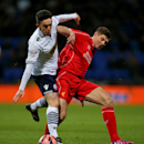 Bolton Wanderers' Zach Clough, left, and Liverpool's Steven Gerrard battle for the ball during the English FA Cup fourth round replay at the Reebok Stadium, Bolton, England Wednesday Feb. 4, 2015. (AP Photo/ Peter Byrne/PA) UNITED KINGDOM OUT