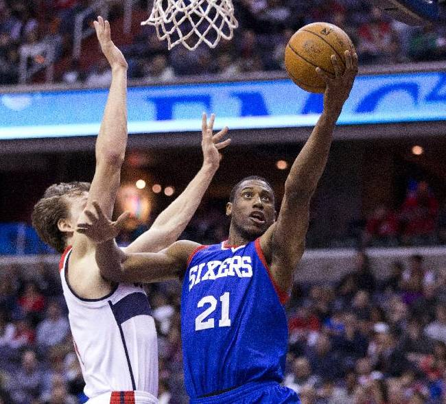 Philadelphia 76ers forward Thaddeus Young (21) scores past Washington Wizards forward Jan Vesely during the first half of an NBA basketball game on Monday, Jan. 20, 2014 in Washington