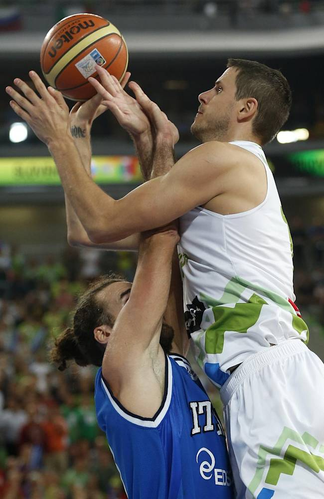 Italy's Luigi Datome, left, challenges Slovenia's Bostjan Nachbar during their EuroBasket European Basketball Championship Group F match in Ljubljana, Slovenia, Thursday, Sept. 12, 2013