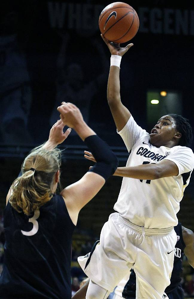 Colorado's Brittany Wilson shoots while being covered by Stanford's Mikaela Ruef during the second half of an NCAA college basketball game, in Boulder, Colo., Sunday, Jan. 12, 2014. Stanford won 87-77