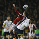 Sheffield United's Mark McNulty, left jumps for the ball as Tottenham's Kyle Walker is fouled during their English League Cup semifinal 1st leg soccer match between Tottenham Hotspur and Sheffield United, at the White Hart Lane stadium in London, Wednesda