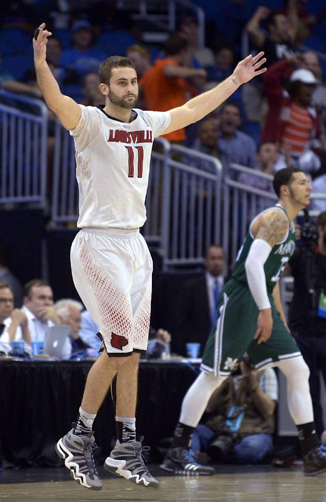 Louisville forward Luke Hancock (11) raises his arms after he hit a 3-pointer late in the second half against Manhattan in a second-round game in the NCAA men's college basketball tournament Thursday, March 20, 2014, in Orlando, Fla. Louisville defeated Manhattan 71-64