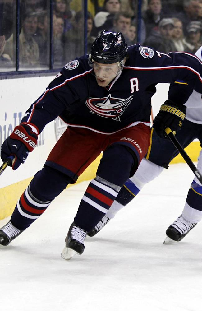 Columbus Blue Jackets' Jack Johnson, left, controls the puck against St. Louis Blues' Alexander Steen in the first period of an NHL hockey game in Columbus, Ohio, Saturday, Dec. 14, 2013
