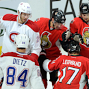 Ottawa Senators' David Legwand, bottom right, gets a tap on the head for a first-period goal from teammates Clarke MacArthur, center, and Erik Karlsson, as Montreal Canadiens' Jarred Tinordi, top left, and Darren Dietz stand nearby during first period of