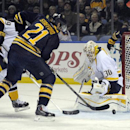 Buffalo Sabres right winger Drew Stafford (21) pushes the puck past Nashville Predators goaltender Carter Hutton (30) for a goal during the first period of an NHL hockey game in Buffalo, N.Y., Tuesday, March 11, 2014 The Associated Press