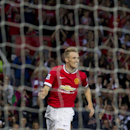 Manchester United's Darren Fletcher celebrates after scoring against Valencia, during a pre season friendly soccer match at Old Trafford Stadium, Manchester, England, Tuesday Aug. 12, 2014