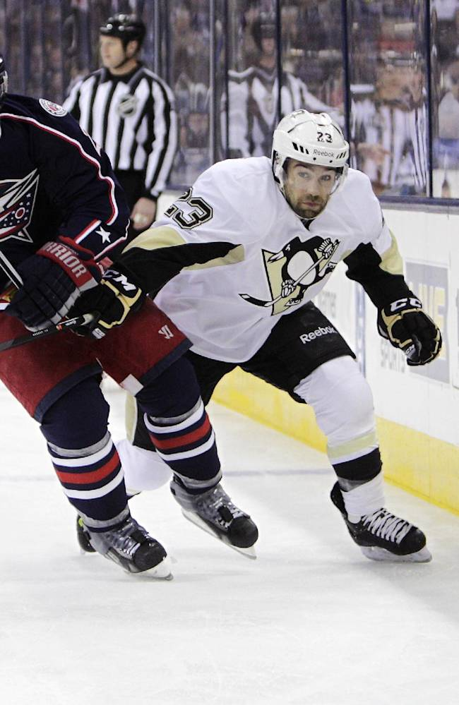 Columbus Blue Jackets' James Wisniewski, left, and Pittsburgh Penguins' Chris Conner chase a loose puck during the first period of an NHL hockey game on Sunday, Dec. 29, 2013, in Columbus, Ohio