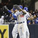Los Angeles Dodgers' Yasiel Puig, center, celebrates with teammates Carl Crawford, left, and Andre Ethier after the Dodgers' 5-1 victory over the San Diego Padres in a baseball game Wednesday, April 2, 2014, in San Diego The Associated Press