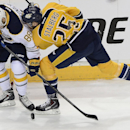 Buffalo Sabres left wing Cory Conacher (88) and Nashville Predators forward Viktor Stalberg (25), of Sweden, battle for the puck in the first period of an NHL hockey game on Thursday, March 27, 2014, in Nashville, Tenn The Associated Press
