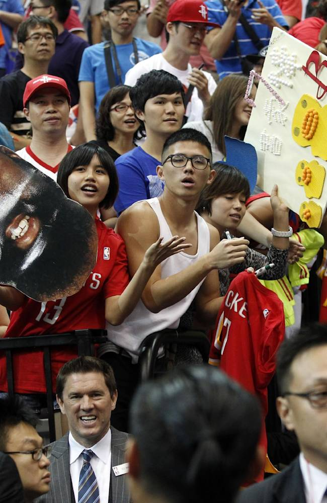 Holding a giant portrait of NBA Houston Rockets star James Harden, fans hope to meet the Rockets players after beating the Indiana Pacers during a preseason game in Taipei, Taiwan, Sunday, Oct. 13, 2013. The Rockets beat the Pacers 107-98