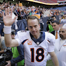In this Dec. 22, 2013, file photo, Denver Broncos' Peyton Manning (18) waves to fans following an NFL football game against the Houston Texans in Houston. Manning threw his 51st touchdown pass of the season in the game to set a new NFL record. Manning's n