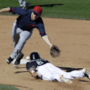 Seattle Mariners' Nick Franklin steals second as Cleveland Indians second baseman David Adams attempts to reach the throw from catcher Matt Treanor in the sixth inning of a spring training baseball game, Wednesday, March 5, 2014, in Peoria, Ariz The Assoc