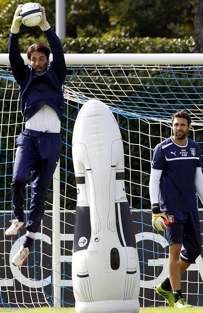 Italian national soccer team goalies, Gianluigi Buffon of F.C. Juventus, left, and Salvatore Sirigu of F.C. Paris Saint Germain, warm up during a training session with their team at the Coverciano sports center, near Florence, central Italy, Wednesday, Oct. 9, 2013, ahead of a 2014 FIFA World Cup, Group B, qualification match against Denmark in Copenhagen on Friday. Italy, already qualified, will play Denmark aiming to rank second in Group B. Other teams in Group B are, Armenia, Bulgaria, Czech Republic, and Malta