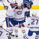 Montreal Canadiens' Tomas Plekanec, second from right, celebrates his game-winning goal with teammates, from left, Tom Gilbert, Andrei Markov, and Alex Galchenyuk during third period NHL action in Toronto on Wednesday, Oct. 8, 2014 The Associated Press