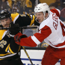 Boston Bruins defenseman Johnny Boychuk (55) collides with Detroit Red Wings' Luke Glendening during the first period of Game 2 of a first-round NHL hockey playoff series in Boston Sunday, April 20, 2014 The Associated Press