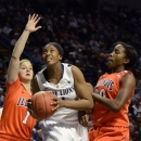 Penn State's Candice Agee, center, looks for a shot past Illinois' Mckenzie Piper (1) and Karisma Penn (00) during the first half of an NCAA college basketball game in State College, Pa., Wednesday, Feb. 20, 2013. (AP Photo/Ralph Wilson)