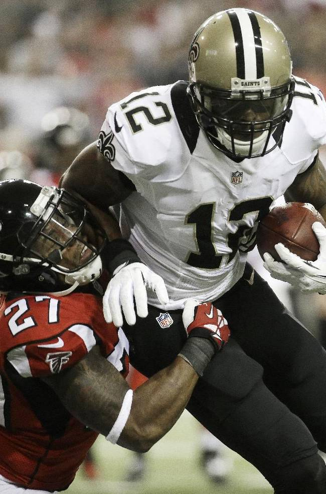 New Orleans Saints wide receiver Marques Colston (12) moves past Atlanta Falcons cornerback Robert McClain (27) during the first half of an NFL football game, Thursday, Nov. 21, 2013, in Atlanta