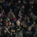 Manchester United goalkeeper David De Gea celebrates after his team's 2-1 win during the English Premier League soccer match between Manchester United and Stoke City at Old Trafford Stadium, Manchester, England, Tuesday Dec. 2, 2014. De Gea made two late