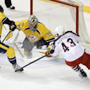 Columbus Blue Jackets left wing Scott Hartnell (43) reaches for a rebound on a block by Nashville Predators goalie Pekka Rinne (35), of Finland, in the second period of a preseason NHL hockey game Monday, Sept. 29, 2014, in Nashville, Tenn The Associated