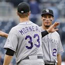 Colorado Rockies' Justin Morneau and Nolan Arenado slap high-fives after the Rockies finished off a 3-1 victory over the San Diego Padres in a baseball game Thursday, April 17, 2014, in San Diego The Associated Press