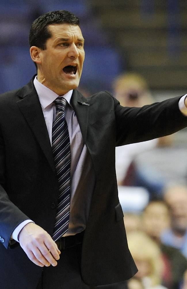 Northern Iowa coach Ben Jacobson directs a play against Southern Illinois in the second half of an NCAA college basketball game in the quarterfinals of the Missouri Valley Conference men's tournament, Friday, March 7, 2014, in St. Louis
