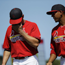 St. Louis Cardinals' Peter Bourjos, left, and Jon Jay walk off the field in the fifth inning of an exhibition spring training baseball game against the Detroit Tigers, Monday, March 10, 2014, in Jupiter, Fla The Associated Press