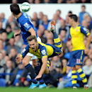 Arsenal's Aaron Ramsey, right, is tackled by Everton's Gareth Barry during the English Premier League soccer match between Everton and Arsenal at Goodison Park, in Liverpool, England, Saturday, Aug. 23, 2014