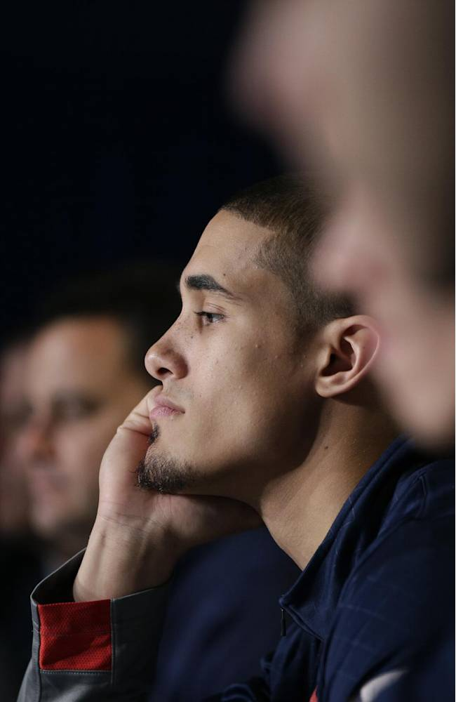 Arizona's Nick Johnson, center, listens to a question during a news conference at the NCAA college basketball tournament on Friday, March 28, 2014, in Anaheim, Calif. Arizona plays Wisconsin in a regional final on Saturday