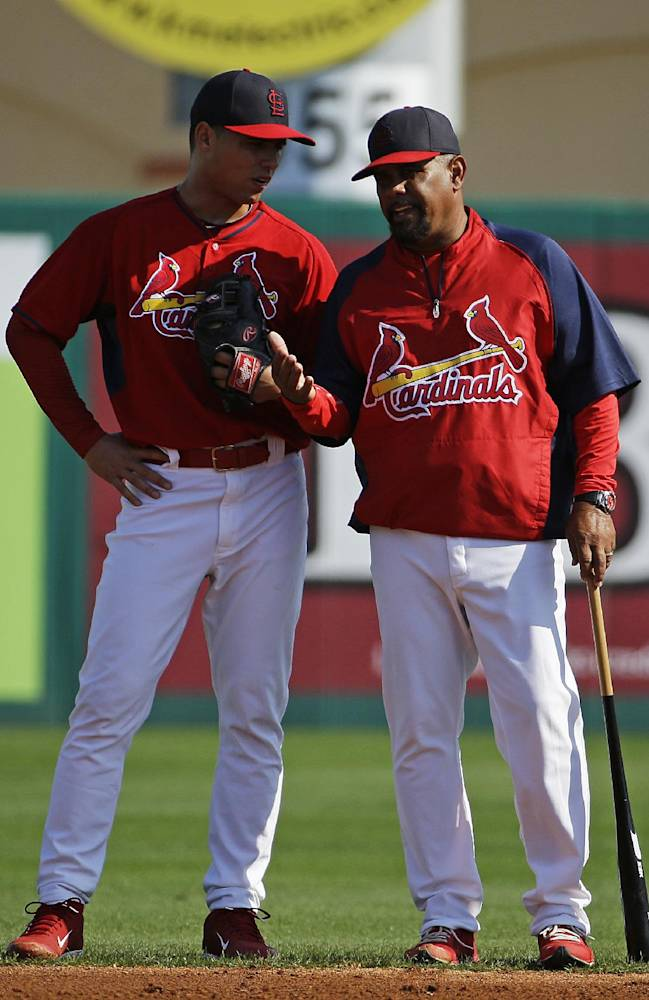 St. Louis Cardinals' Aledmys Diaz, left, talks with third base coach Jose Oquendo during practice before the start of an exhibition spring training baseball game against the Detroit Tigers, Monday, March 10, 2014, in Jupiter, Fla. Diaz reported to spring training Monday after the Cardinals signed the Cuban free agent shortstop to a major league contract. The Cardinals were among a number of teams, including the Yankees, who held private workouts for the right-handed hitting Diaz and the deal is believed to be for $15-20 million for four years
