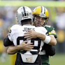 Green Bay Packers' Aaron Rodgers hugs Oakland Raiders' James Jones before an NFL preseason football game Friday, Aug. 22, 2014, in Green Bay, Wis. Jones played for the Packers before the Raiders The Associated Press