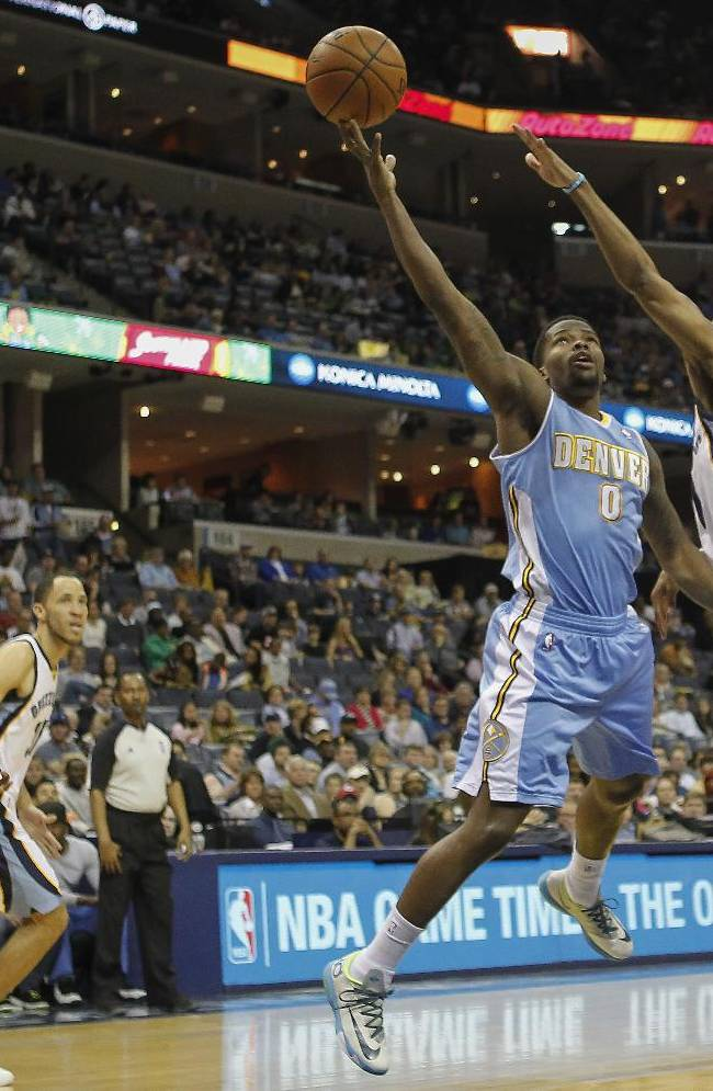 Denver Nuggets guard Aaron Brooks (0) goes to the basket against Memphis Grizzlies guard Mike Conley (11) in the first half of an NBA basketball game Friday, April 4, 2014, in Memphis, Tenn