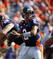 Illinois quarterback Nathan Scheelhaase (2) looks to throw a pass against Miami (Ohio) during the first half of an NCAA college football game on Saturday, Sept. 28, 2013, at Memorial Stadium in Champaign, Ill. (AP Photo/Jeff Haynes)