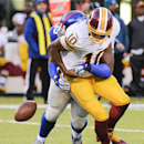 Washington Redskins quarterback Robert Griffin III (10) fumbles the ball as he is sacked by New York Giants defensive tackle Johnathan Hankins (95) during the fourth quarter of an NFL football game, Sunday, Dec. 14, 2014, in East Rutherford, N.J. (AP Photo/Bill Kostroun)