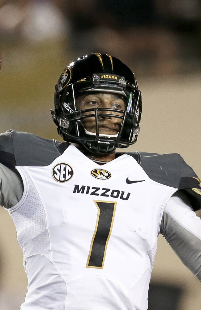 Missouri quarterback James Franklin passes against Vanderbilt in the first quarter of an NCAA college football game on Saturday, Oct. 5, 2013, in Nashville, Tenn