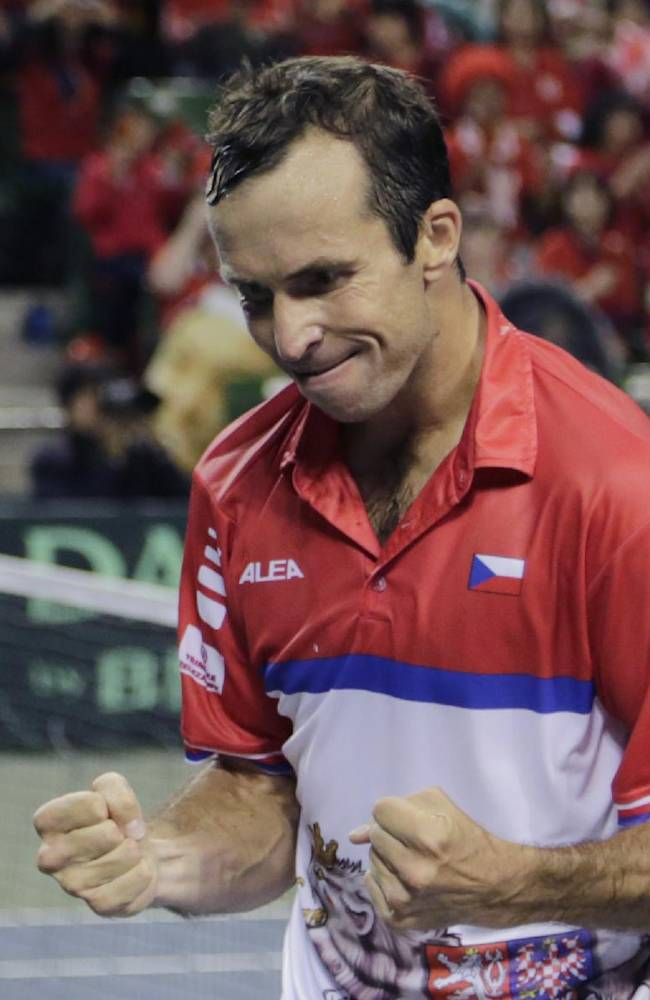Radek Stepanek of the Czech Republic reacts after defeating Tatsuma Ito of Japan during their quarterfinal of Davis Cup World Group tennis at Ariake Colosseum in Tokyo, Friday, April 4, 2014. Stepanek won 6-7, 7-6, 6-1, 7-5