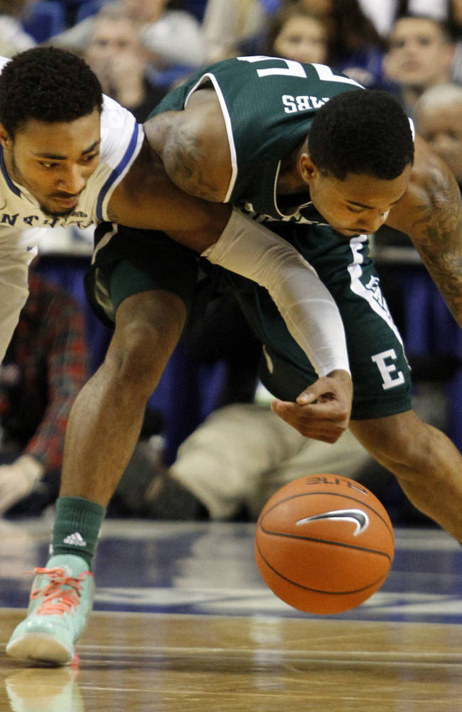 Kentucky's James Young, left, and Eastern Michigan's Darell Combs chase down a loose ball during the second half of an NCAA college basketball game on Wednesday, Nov. 27, 2013, in Lexington, Ky. Kentucky won 81-63