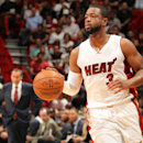 Led by Wade, Heat stun James and Cavaliers, 106-92 The Associated Press