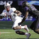 Stanford's Ty Montgomery carries the ball as Washington's Cory Littleton moves in in the second half of an NCAA football game Saturday, Sept. 27, 2014, in Seattle. Stanford won 20-13.(AP Photo/Elaine Thompson)