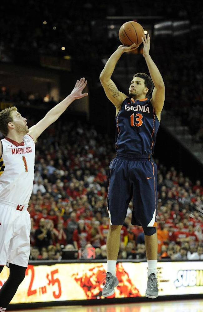 Virginia forward Anthony Gill (13) takes a shot against Maryland forward Evan Smotrycz (1) during the first half of an NCAA college basketball game, Sunday, March 9, 2014, in College Park, Md