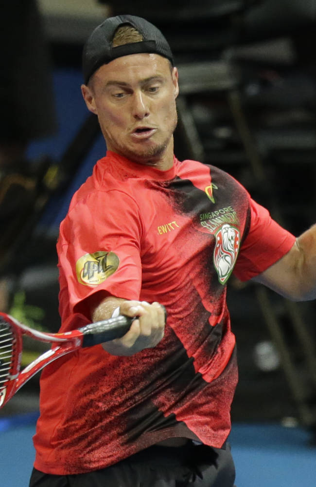 Lleyton Hewitt of Singapore Slammers  return a serve from opponent Gael Monfils of the Indian Aces during their IPTL (International Premier Tennis League) singles match Friday, Nov. 28, 2014 at the Mall of Asia Arena at suburban Pasay city, south of Manila, Philippines. The IPTL, featuring four teams, introduces a new format in tennis and a chance for a championship prize of $1-million dollars