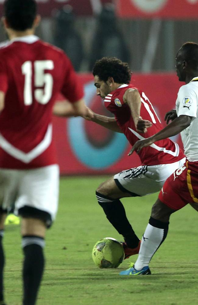 Egypt's Mohamed Salah controls the ball during the World Cup qualifying playoff second leg soccer match, at the Air Defense Stadium in Cairo, Egypt, Tuesday, Nov. 19, 2013. Ghana qualified for its third straight World Cup, defeating Egypt on 7-3 aggregate with a 2-1 loss Tuesday that knocked out the Pharaohs and American coach Bob Bradley