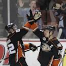Anaheim Ducks' Patrick Maroon, left, and Ryan Getzlaf celebrate their team's 5-2 win against the San Jose Sharks after an NHL hockey game on Wednesday, April 9, 2014, in Anaheim, Calif. The Ducks clinched their second straight Pacific Division title. (AP Photo/Jae C. Hong)