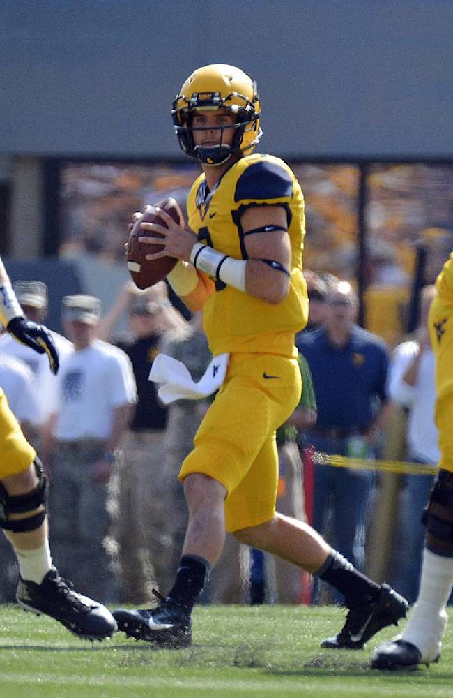 Different QBs starting for West Virginia, Baylor
