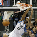 Minnesota Timberwolves' Corey Brewer dunks in the second half of an NBA basketball game against the Detroit Pistons, Friday, March 7, 2014, in Minneapolis. The Timberwolves won 114-101 The Associated Press