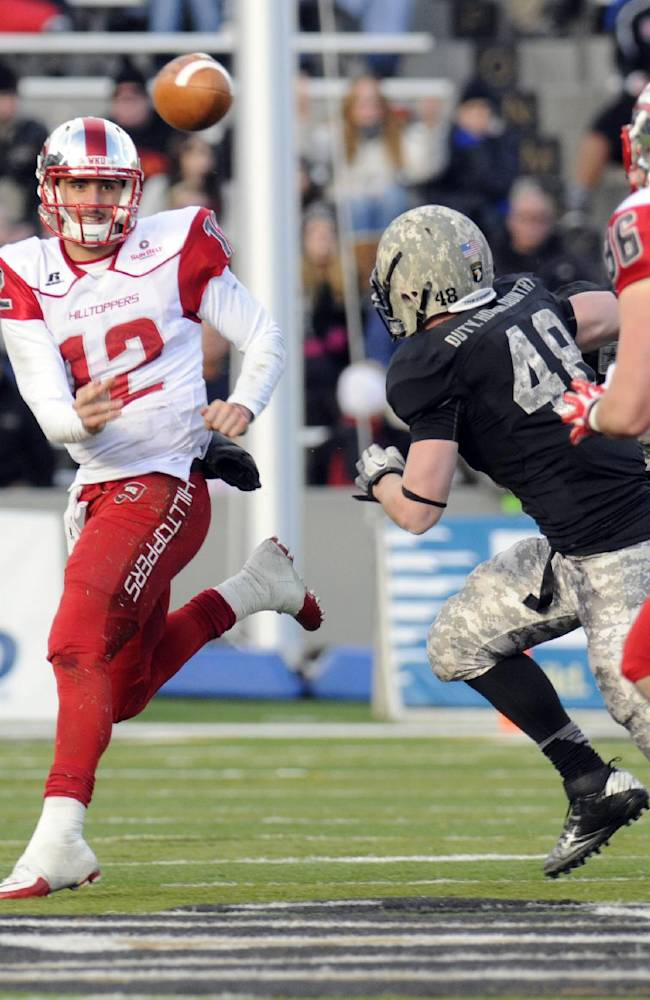 Western Kentucky quarterback Brandon Doughty (12) throws a pass against Army during the first half of an NCAA college football game Saturday, Nov. 9, 2013, in West Point, N.Y