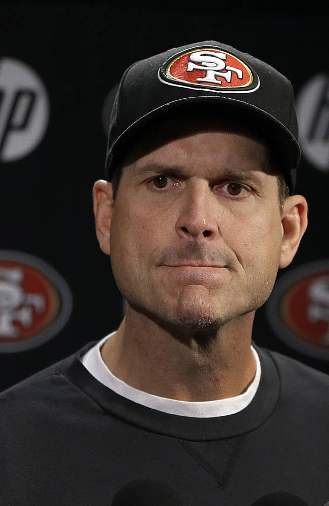 San Francisco 49ers coach Jim Harbaugh listens to questions during an NFL football media conference, Tuesday, Jan. 21, 2014, in Santa Clara, Calif