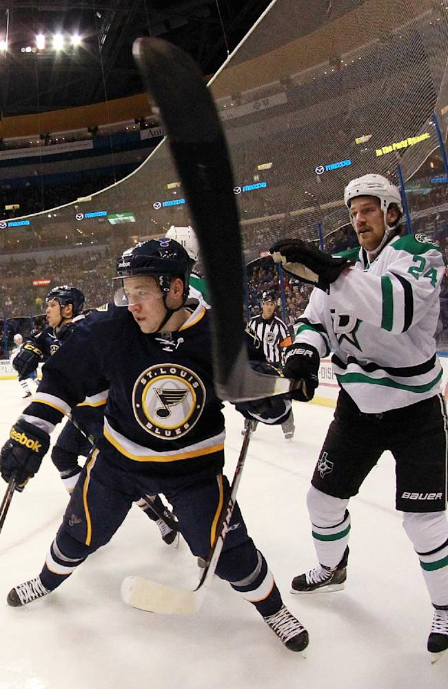 St. Louis Blues right wing Vladimir Tarasenko (left) battles for position against Dallas Stars defenseman Jordie Benn in first period action during a game between the St. Louis Blues and the Dallas Stars on Saturday, Nov. 23, 2013, in St. Louis