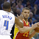 Houston Rockets' Chandler Parsons (25) looks to pass the ball around Orlando Magic's Arron Afflalo (4) during the first half of an NBA basketball game in Orlando, Fla., Wednesday, March 5, 2014 The Associated Press