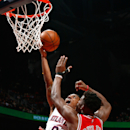 ATLANTA, GA - DECEMBER 15: Jeff Teague #0 of the Atlanta Hawks drives against Jimmy Butler #21 of the Chicago Bulls at Philips Arena on December 15, 2014 in Atlanta, Georgia. (Photo by Kevin C. Cox/Getty Images)